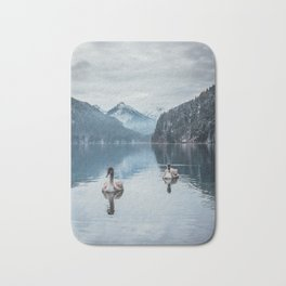Couple of swans, romantic scene in bavarian alps Bath Mat