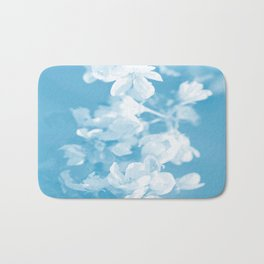 Spring Atmosphere White Flowers Sky Blue Background #decor #society6 #homedecor Bath Mat