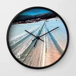Winter road into the mountains Wall Clock