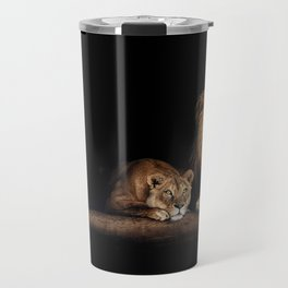 Cute lion and lioness - happy big cat family lie on the wooden log. Beautiful animals photo on dark background Travel Mug