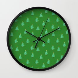 Christmas trees in a green forest Wall Clock