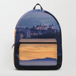 The Alhambra Palace and Granada. Misty sunset. Panoramic Backpack