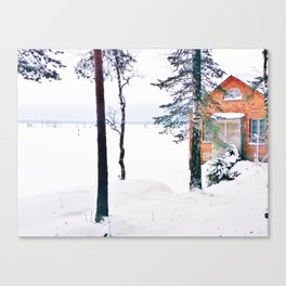 Icy lake view with red brick house Canvas Print