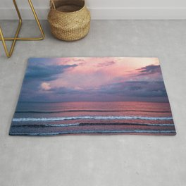 Pink sunset at the beach Rug