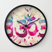 om Wall Clocks featuring OM by Pranatheory