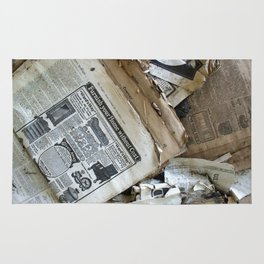 Old Newspaper Left to the Elements...Furnish Your Home in Style Rug