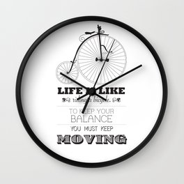 Life is like riding a bicycle to keep your balance you must keep moving Wall Clock