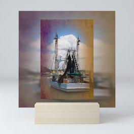 Moored boat on a river Mini Art Print