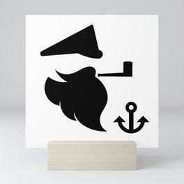 Sea captain with a smoking pipe Mini Art Print
