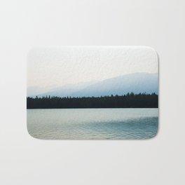 Misty Mountains - Lake Annette in Jasper, Canada Bath Mat