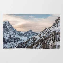 Mountains at sunset - Alpine snowy landscape Rug