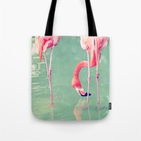 flamingos Tote Bags featuring Flamingos  by Laura Ruth