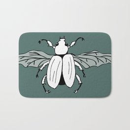 It's a beetle and it has wings. Bath Mat