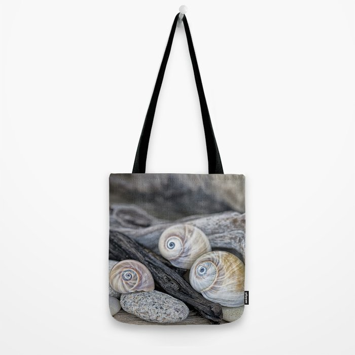 Shark's eye shells and driftwood Tote Bag