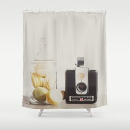 a vintage kodak brownie camera with delicious french macarons Shower Curtain
