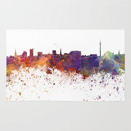Dortmund skyline in watercolor background Rug