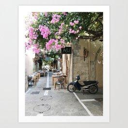 Greek street with pink cherry blossom tree Art Print