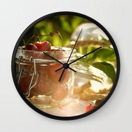 Fresh cherrie in glass Wall Clock