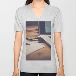 The side of a laptop Unisex V-Neck