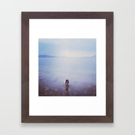 Swimming dog Framed Art Print