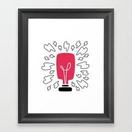 Light Bulb Shining on White Framed Art Print