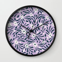 White flowers over a purple background Wall Clock