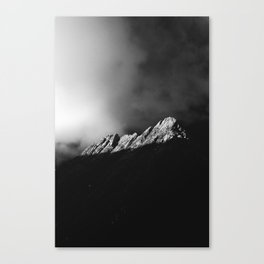 Last sun rays on the mountain in black and white Canvas Print