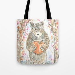 A bear bearing a pumpkin Tote Bag
