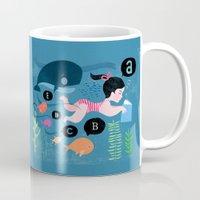 swimming Mugs featuring Swimming by Sugar Snap Studio