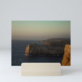 Sunset glow on cliffs of Sagres Portugal Mini Art Print