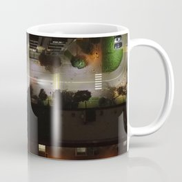 Aerial view of a city district illuminated by night lights Coffee Mug