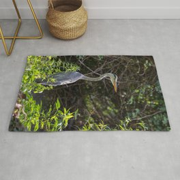 Gray heron on the edge of a pond Rug