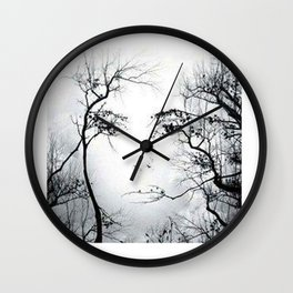 face in the trees Wall Clock