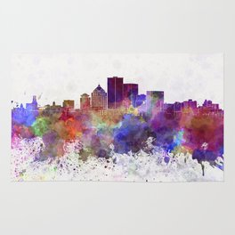 Rochester NY skyline in watercolor background Rug