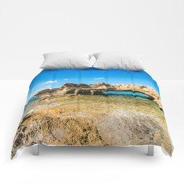 Grotto seascape Comforters
