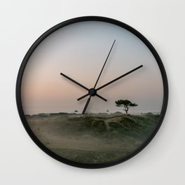 Lonely tree in the foggy Dunes    Travel photography green hills smoky nature landscape calm Wall Clock