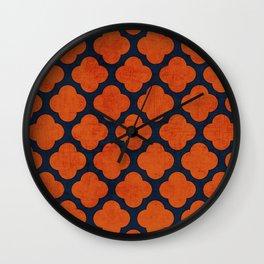 navy and orange clover Wall Clock