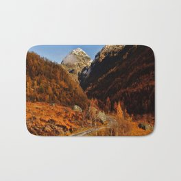 Fall in the mountains with a winding road Bath Mat
