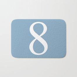 number eight sign on placid blue color background Bath Mat