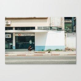 Reading the Paper, Yangon Canvas Print