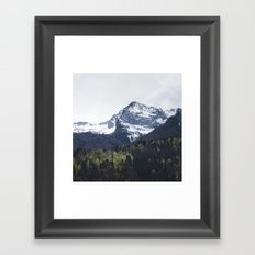Winter and Spring - green trees and snowy mountains Framed Art Print
