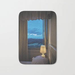 Panoramic view of the rolling hills of Chianti through a window at sunset Bath Mat