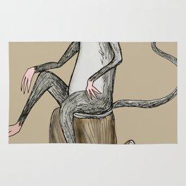 Monkey sitting on a log Rug