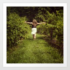 Young woman running through a vineyard Art Print