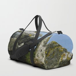 Lichen Covered Rocks in Front of the Blue Horizon Duffle Bag
