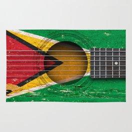 Old Vintage Acoustic Guitar with Guyanese Flag Rug