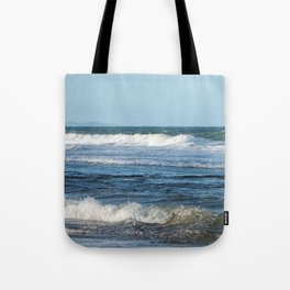 Waves and distant headlands in Queensland, Australia Tote Bag