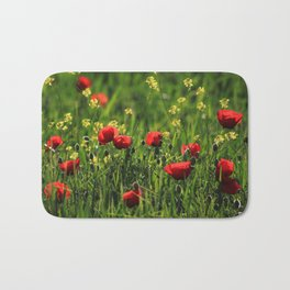 Field with green grass, yellow & red wild flowers in a sunny day Bath Mat