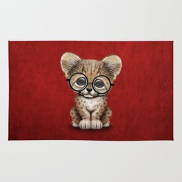 Cute Cheetah Cub Wearing Glasses on Deep Red Rug