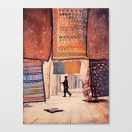 Carpet salesman in the Saharan desert town of Douz, Tunisia.  Colorful artwork Tunisia carpet Canvas Print